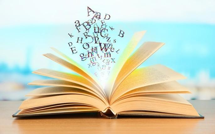 letras saindo do livro